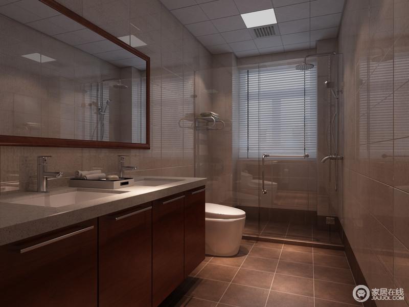 卫生间线条简单,褐色地砖与驼色地砖以色彩层次加强空间的美感,再加上分离式设计,更易于打理;卫生间盥洗台搭配镜子,让生活足够简洁、大气。