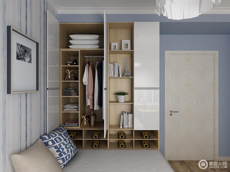 书房粉刷了蓝色漆,让空间足够清爽,而蓝白条纹壁纸的搭配,增加了空间的线条之美;榻榻米旁的定制柜,增加了收纳空间,同时,营造轻松的生活氛围。