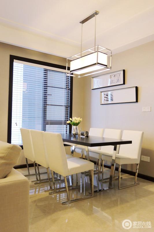 餐厅布置的非常简约,两排白色的座椅搭配着铁艺实木餐桌,黑白色调间尽展优雅就餐环境。