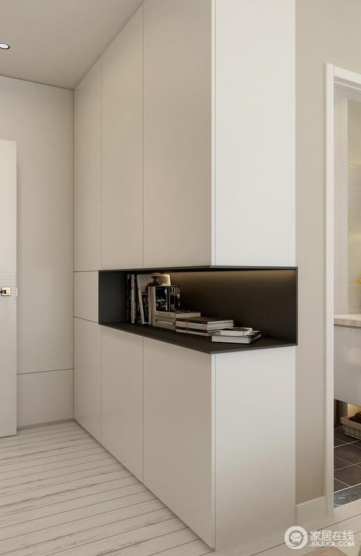 入口区的小空间看似狭小,但是设计师特地做了定制性设计,白色储物柜简单的直线横平竖直,减少不必要的装饰线条,用直线强调空间的开阔感,同时增加空间感,让人们在其中倍感舒适与清爽。