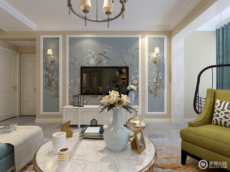 蓝色的花枝背景墙搭配上白色方形石膏框,让墙面富有层次感,与造型石膏线相得益彰。