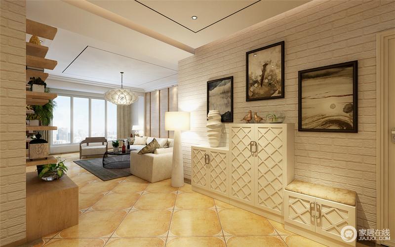 门厅以白色小文化墙砖与美式米色仿古砖为搭配,文艺而不失温度,并突出了砖石的肌理美;艺术挂画和高低错落的菱形鞋柜将不同形式的美呈现在空间,落地灯的憨态,增加了一份趣意,同时,不失生活所需的实用。