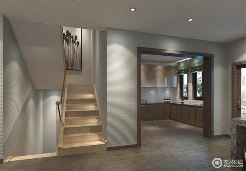 简洁落落大方的文化砖墙,体现出朴质的情绪。简约的厨房一如墙面的利落,简约中透着淡定,也与一侧楼梯形成色调上的呼应,使空间形成联动。