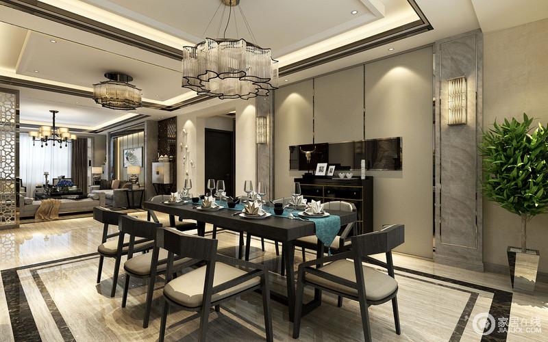 餐厅以开放式的设计来延伸空间感,整个空间规整利落,几何吊顶以嵌入式灯带来加重立体感,也正好与几何墙面、黑砖线地面相呼应;现代风格的餐桌餐椅搭配水晶吊灯,让就餐气息更为有格调。