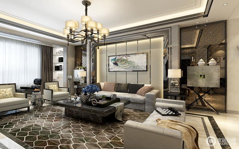 客厅的几何吊顶平面感很强,简单利落,吊灯满足主照明需求,而台灯放置在沙发两侧,营造情景;灰色系沙发组合搭配褐色几何地毯、黑檀木茶几,让空间沉稳而富有现代感,从阳台的储物柜到时尚的边柜,一器一物,组合出家的大气。