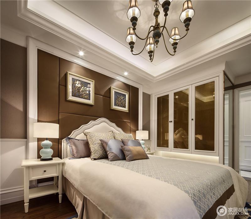 卧室在整体设计上简洁中多了一份柔美,白色+棕色的搭配让空间显得温暖舒适。