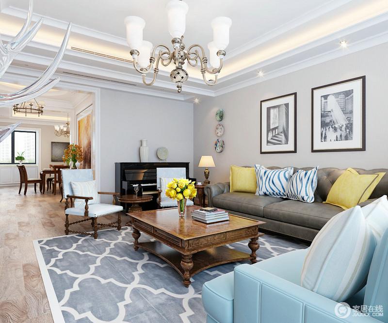 客厅以浅灰色和白色为底色,营造了一个足够素静的生活氛围,而灰蓝色菱形地毯搭配深灰色和蓝色沙发构成美式时尚,靠垫多色的点缀,让生活色彩丰富,足够优雅。