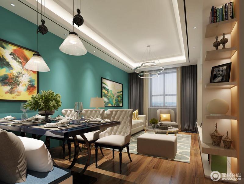 蓝色的墙面、呼应的画作使餐厅与客厅亲密的联系在一起,吊灯的不同无形中又形成独立化的空间形式。软包型沙发与卡座混搭,在精致的餐具点缀下,餐厅更具时尚舒适兼实用性。