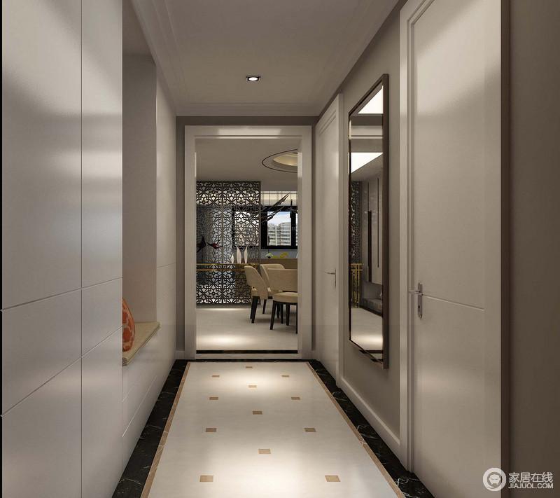 地面方块砖的点缀,让原本平静的空间多了些许立体的简洁,定制的鞋柜充分发挥了空间的功能,增加了储物区,分外实用;而墙面的挂镜,让主人很好的整体自己,也巧妙地提升了空间的明快度。