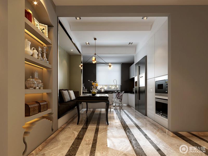 餐厨一体的开放式空间,增加了家人间的交流;厨房黑白色调延展至餐厅背景墙,家电被巧妙的融于墙内;休闲卡座混搭塑料餐椅,兼具时髦优雅与舒适浪漫;面对走廊的壁龛墙,增添展示收纳功能。