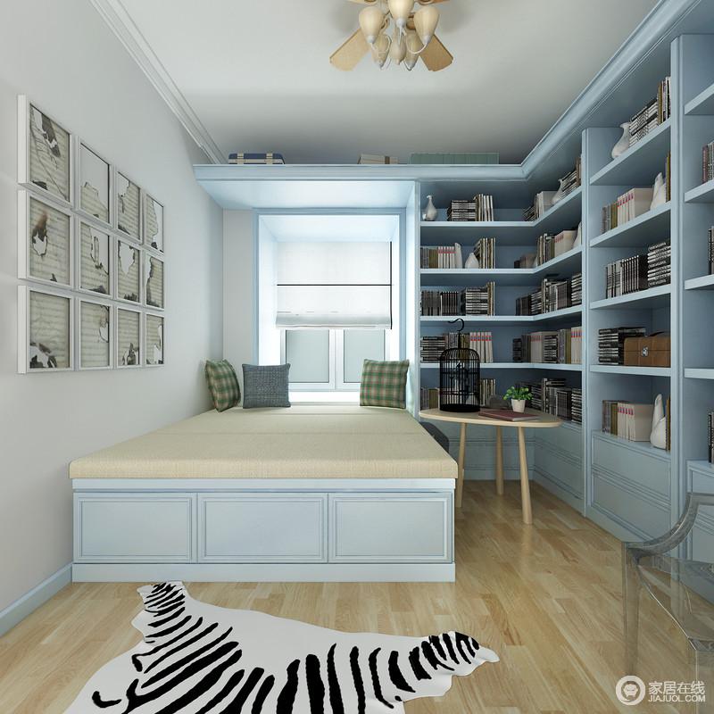 书房内蓝色实木书柜藏满了主人的书,清新之余,带来一种文艺气息;简欧的设计看似少了繁复,却足够大气。