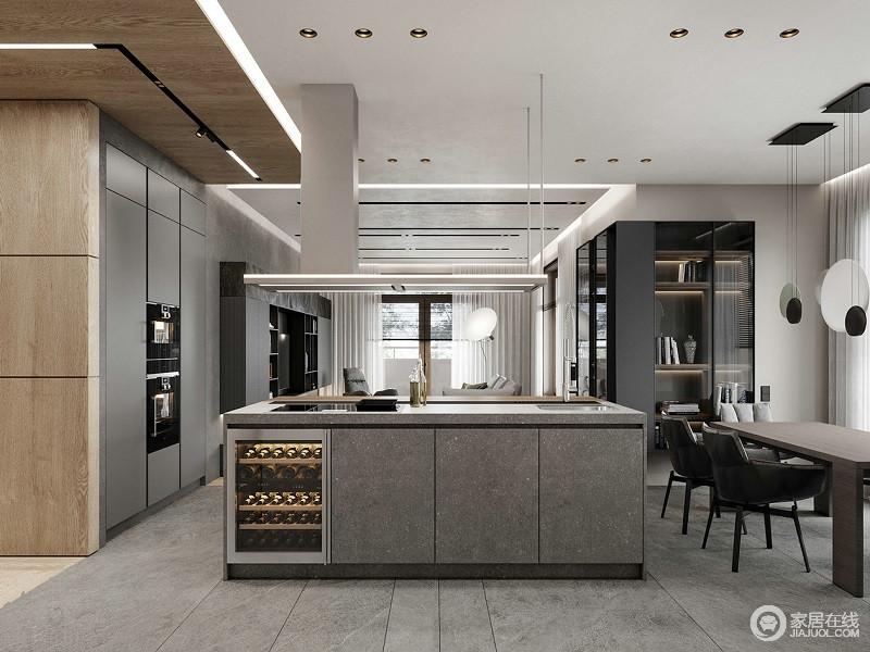 厨房用了开放式的设计更加的符合现代生活理念,利用墙面柜的方式增强空间的实用性;黑灰色柜面与乳灰色岛台形成反差,张扬现代大气。