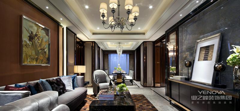 客厅以灰色为主,棕色呼应,体现出的都是主人尊贵的品质和对生活的向往。