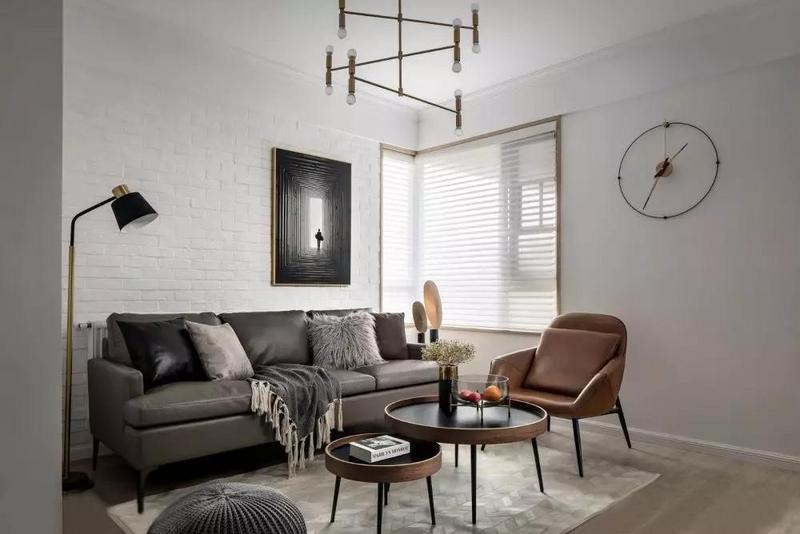客厅,纯净素雅的底色与线条纹理相互渗透,将冷色调的简约与高级展现得淋漓尽致。
