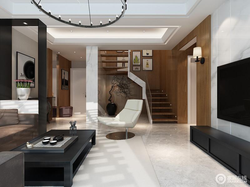 客厅内的结构十分多变,吊顶的几何,楼梯的曲线和层叠效果,以新颖的设计,让空间具有结构美学;挂画、家具等有趣地陈列,给予生活不一样的雅致。