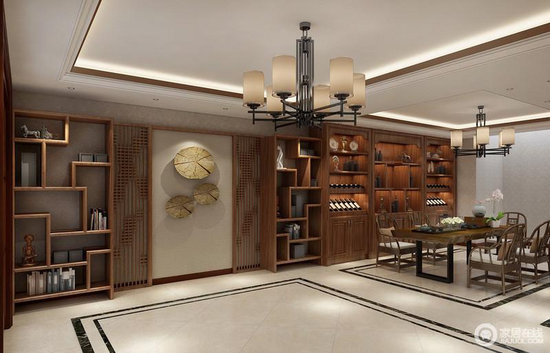 休闲茶室的空间非常大,设计师利用天花板和地面线条无形中划分着空间功能;墙面上做了大量的收纳格架,简洁的博古架和厚重的酒柜架搭配组合,加上花窗和自然配饰的装饰点缀,让空间既实用又充满格调。