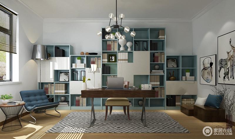书房线条整洁,空间内定制得书柜不仅成就了生活的收纳艺术,同时,蓝白色板材让空间多了份干练和时尚;从挂画组合到现代家具组合,打造了一个具有文艺气息的安静之所。