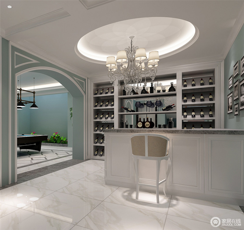地下室被分区设计,分别为酒柜和娱乐室,可以说,成为主人的一个私密性放松空间;圆形的穹顶与微拱形的门体让空间具有结构上的变化,再加上蓝白的搭配,更是多了不少清和,酒柜的设计以功能为主,与吧台组合,可以尽情畅饮。