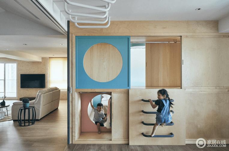 最有趣的区块莫过于多功能和室与儿童房设计,两区不用实体墙分隔,而是设置秘密基地般的大衣柜,搭配粉色圆形洞口柜门及滑轨设计,不同造型的柜门片也可灵活上下对换,自由调整房间进出口位置。天花板还设有吊单杠拉把,让衣柜成为时而封闭、时而穿透的鸟瞰平台,丰富的穿梭性满足玩躲猫猫的缤纷乐趣。