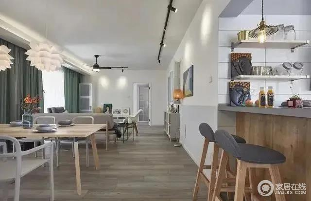 开放式的厨房设计了一个小吧台,墙面上的隔断可以摆放酒具,厨房用品,搞怪的插画体现了主人俏皮的个性,也免去了厨房与用餐区距离太远的空旷感。
