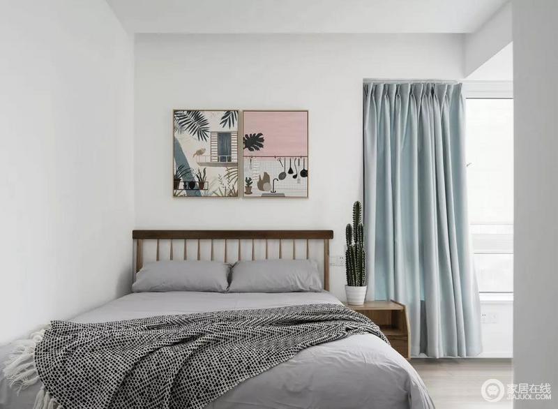 次卧相较于主卧整体更为简约,硬装依旧是白色,与挂画搭配不显单调。软装用灰色与原木色搭配,传达一种自然清新的视觉感受。