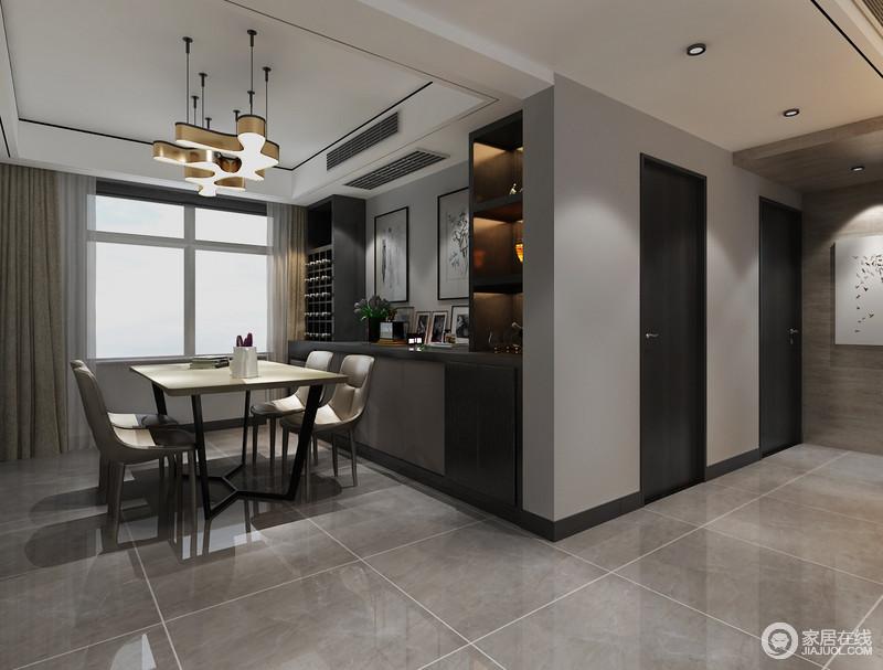 餐厅以深灰色漆粉刷墙面与地砖的色调让整个空间过于冷调沉寂,一组褐色酒柜和橱柜定制而成,收纳之余,令空间更为规整;金属吊灯陪衬着现代感的家具添置亮色,温暖了空间。