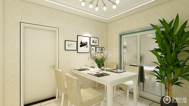 餐厅以米色为主,再加上暖白色的灯光设计,无疑,让整个空间颇显温馨;白色餐桌餐椅组合简单却实用,搭配墙面抽象的画作,更是多了一份淡淡的文艺气息。