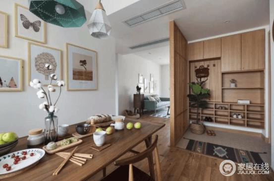 入口玄关利用木质屏风打造了一个略为开房的空间,让收纳更为规整和利落;而旁侧的实木家具简约而温实,一器一物间都流露出生活的简单,同时,空间多了禅静。