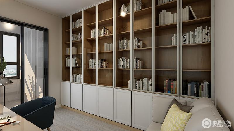 书房的背面做得是一排整体的高柜,我们的女主人是个非常热爱读书的文艺青年,这样的设计显得空间整体性更好,也能满足业主书物的储放,也可以变成一个艺术的背景墙。