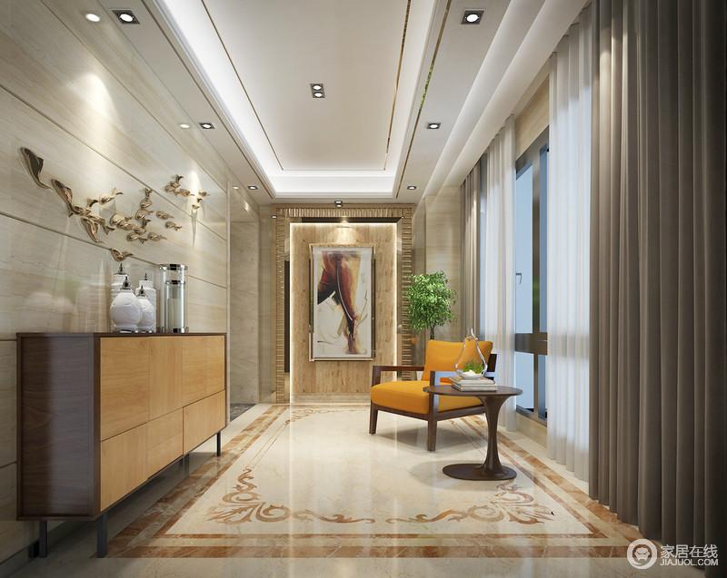 门厅设计得十分别致,从吊顶的嵌入式灯带设计到地砖的拼花,在矩形结构的基础上,演绎不同的材质之美,而壁画和墙饰的点缀,提升了空间的艺术陈列之美,十分大气;原木边柜的储物功能,橙色实木扶手椅和圆几的搭配,让你回家也感到一阵暖意。
