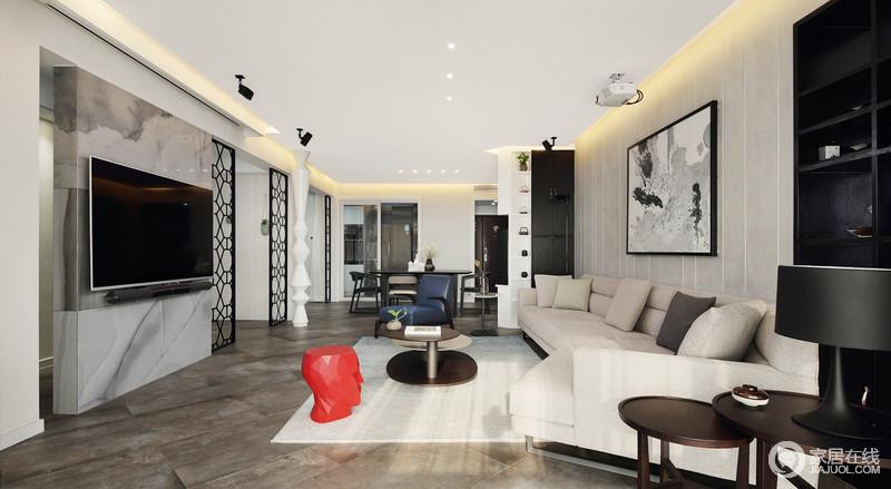 客厅线条简单,吊顶内的灯带加重了吊顶的几何感,缓解了黑白色空间的抽象单调;米白色布艺沙发因为红色艺术品坐凳、白色艺术柱、书架让空间既不失艺术气息,又增添了实用性;可以说简单的设计,以艺术陈列的讲究,成就了生活的都市质感。