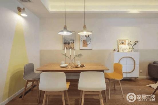整个餐厅区域的亮点,就是墙壁上黄色乳胶漆仿绘的光束,增加趣味性让空间不单调;而木桌上的烛台搭配餐椅,让整个空间多了情调。