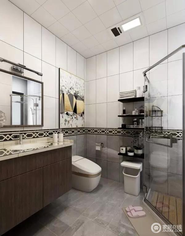卫生间采用干湿分离设计,且充分利用各个角落进行收纳,充分提升日常使用的便捷性。墙面地面均采用瓷砖铺贴,采用灰白双色拼搭,通过纹理丰富的腰线过渡。墙体的上半部分瓷砖与集成吊顶的纹理和谐统一,下半部的灰色瓷砖则融入于地面的风格,使得空间整体的统一性极佳。