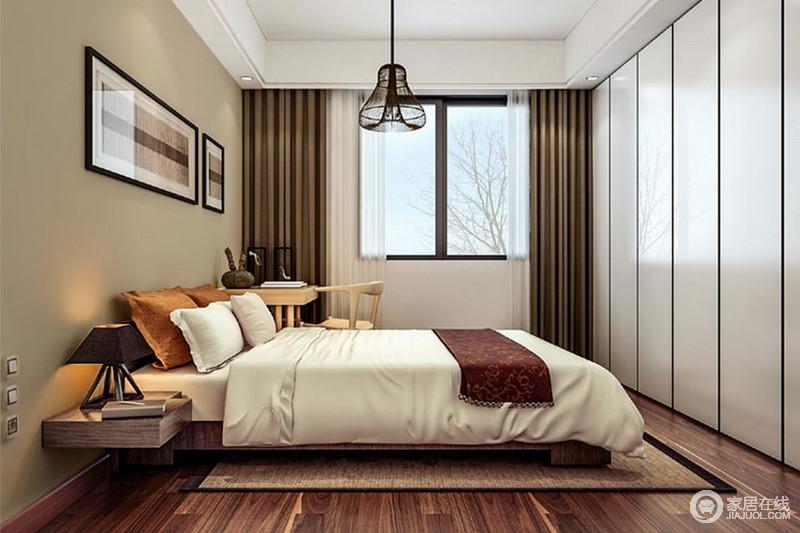 卧室结构上十分规整,驼色漆粉刷的背景墙与通体式烤漆衣柜的条形设计构成对比,满是简洁;实木家具设计的轻简实用,一个床头柜和书桌的搭配,满足主人的生活之需,延续着自然温实,而褐色窗帘与白色床品在色彩反差之中,渲染出生活的温馨。