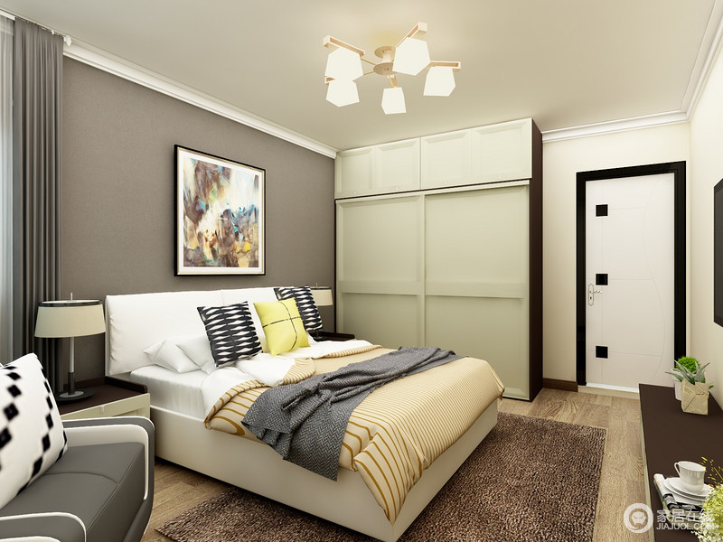 卧室两面墙采用了部一样的颜色,这样撞色的设计给空间带来了一种独特的美,到顶的定制衣柜充分利用了空间来储物,床边放一张单人沙发,让卧室额外有了休闲的功能。