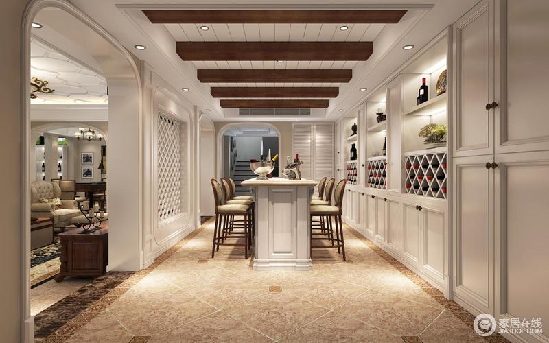 地下的休闲室将褐色实木裸露地木梁与定制得酒柜和墙面的白色调构成强烈的对比,让空间更富格局;吧台的收纳,与实木高脚凳的美式复古,让整个空间多了美式优雅与轻奢,酒柜的菱形与矩形,几何之中找到生活的动律。   客户平常在家接待朋友的需求很高,喜欢美式风格,同时喜欢优雅高雅的风格,带有现代风格的元素,所以为自己居所选择了美式风格
