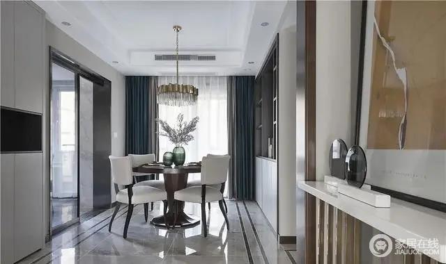 餐厅延续客厅的高级感,黑白灰的配色以及多种材质的穿插运用,打造轻奢高端的空间格调。