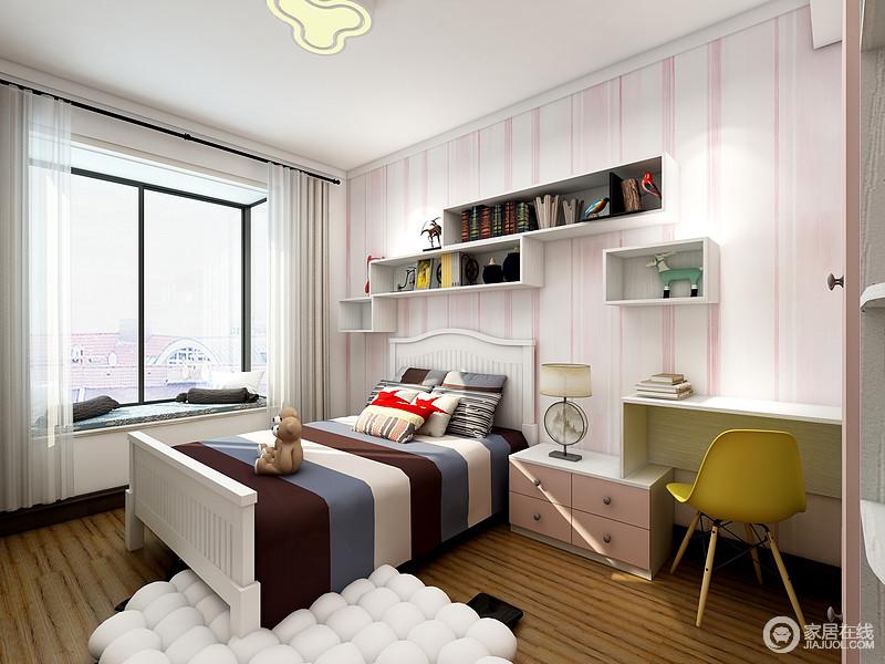 儿童房以粉白条纹壁纸来铺贴墙面,渲染了一个纯净而甜美的空间氛围;悬挂柜解决了储物的的难题,搭配飘窗,组合出一种收纳艺术;条纹状床品和泡沫状的地毯调和了空间的用色,没有破坏空间的格调,反而,让孩子能够生活的舒适。