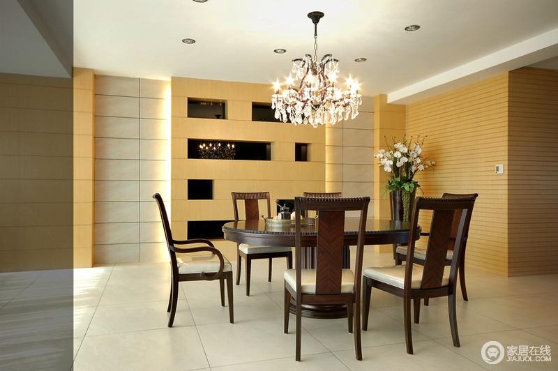 餐厅结构方正,落地窗给予空间足够的采光,与简欧水晶灯造就明快;墙面做成了几何收纳格给生活带来几分妙趣,现代餐桌椅组合,让生活够简单和温馨。