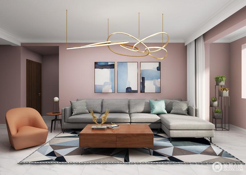 客厅主色调以粉色为主,搭配地砖的白灰色,呼应了家居时尚,素雅之中藏有浪漫气息;灰色的沙发搭配橘色单椅沙发时尚不单调,而异形图案的地毯,呼应着挂画,给予整体空间和谐,也带着一种跳跃,让生活多了一份色彩的优雅;阳台空间的绿植为空间添加绿意与活力,与个性的圈形吊灯讲述了设计的个性,也传递出生活所追求得简单和舒适。