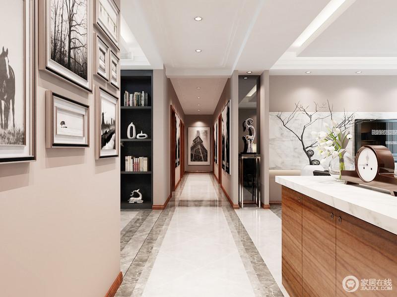 整个空间利用墙面实现储物的需求,嵌入式书柜和雕饰摆件,装饰出生活的文艺气息;而砖线的铺贴形式,既划分空间,也增加了地面的艺术感,搭配墙面的挂画,妆点出家的雅致。