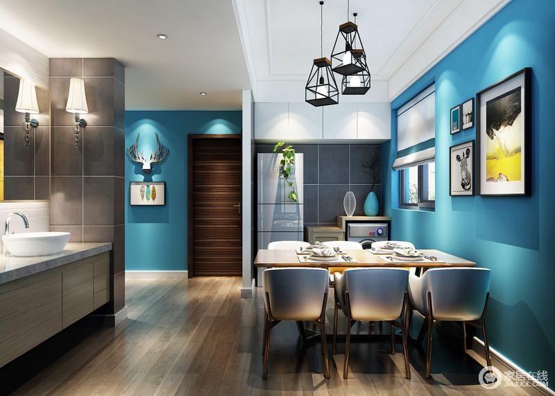 餐厅的设计与设计主题一脉相承,带着忧郁,也带着清冷与白色吊顶构成蓝白调,让餐厅别彩重生;黑色铁艺吊灯的工业个性和多趣的艺术画以截然不同的内涵装点着餐厅,呈现着深情款款的优雅。