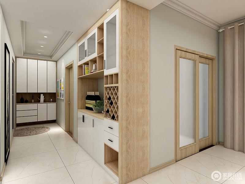 门厅区米白色地砖铺贴出了洁净感,白色定制得鞋柜既规整,又放大了空间的功能;并借空间墙面的位置,将走廊区做成了一个功能型的储物区,既让空间实用性倍增,又让空间多了美观。