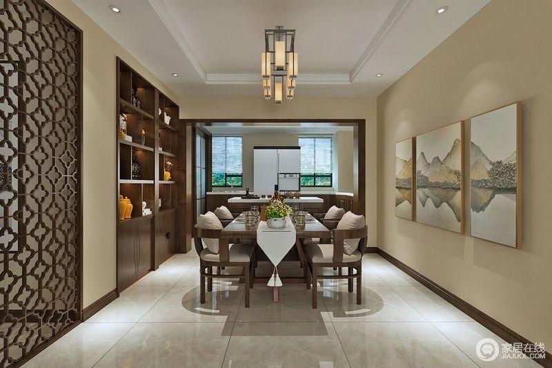 餐厨空间看似一体式设计,但是木框装裱的墙体将餐厨两室分隔,让功能更为明确,褐色实木橱柜定制设计,而岛台带来实用,并带来一种现代大气;米色墙面因为实木镂空屏风多了空灵感,与实木收纳柜的厚重呈对比之态,山墨画的禅韵与灯光的和暖凝结出东方雅致;而实木餐桌上的桌巾带着中式艺术,与实木半圆餐椅构成新中式之雅。