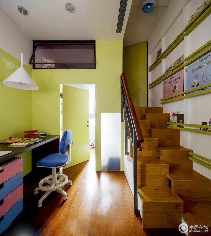 儿童房坐落在空间的一个角落,为了解决采光上的问题,将空间粉刷成了青柠色,多了青春的色彩;蓝粉色的家具组合实用为主,而木地板连着楼梯,给予空间立体结构与平面效果,动静结合。