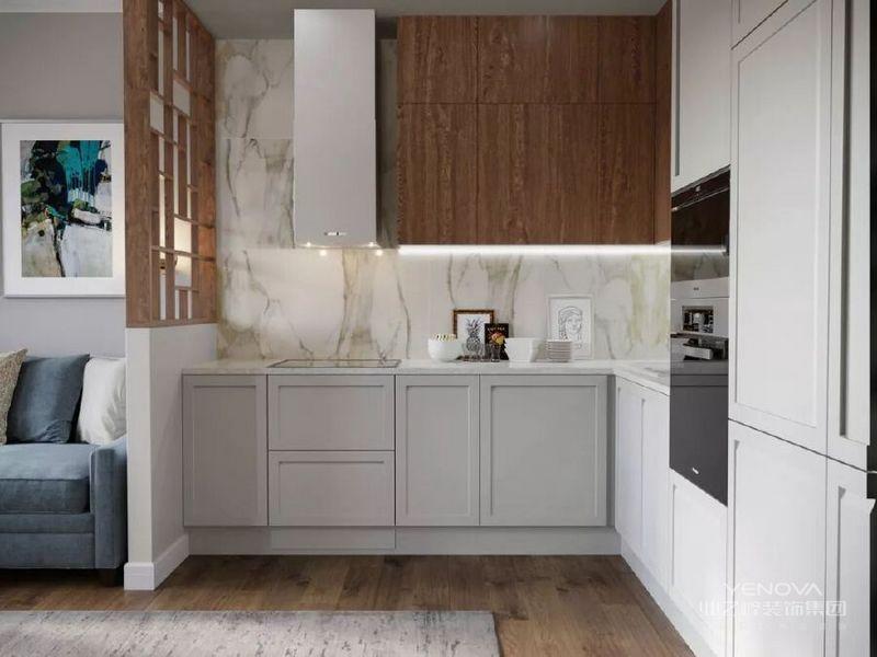 灰白色调的橱柜拓宽了料理区域原本小稚的视觉感受,同时很好的起到了它储藏、收纳的作用。