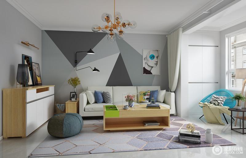 以灰色调为主的客厅,墙面以绒灰为背景色,蓝色做为点缀,跳色的使用让室内整个空 间内不沉闷,纯木色的收纳茶几和边几解决了客厅杂乱物件的收纳,简洁明快贯彻在整 间房间的每个细节。
