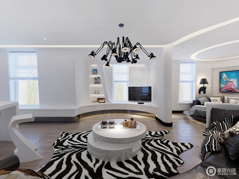 休闲室与书房是一体式空间,以开放式的格局,让生活更无拘束感;白色立面与原木地板,简单而朴质,但是斑马纹地毯和错落的茶几,工业风的吊灯组合出了黑白艺术,让读书或者休闲更富艺术情调。