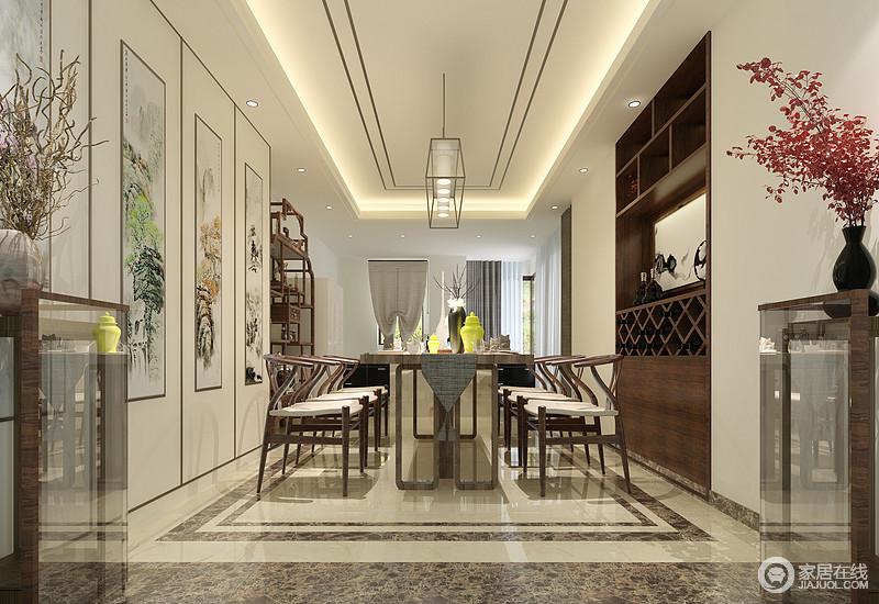 中式讲究规矩和中庸,仿古餐椅对称整齐的围合在餐桌前,桌上花瓶色调调皮,与墙上山水挂画、花架上花束,点映出空间里的自然悠闲情调。