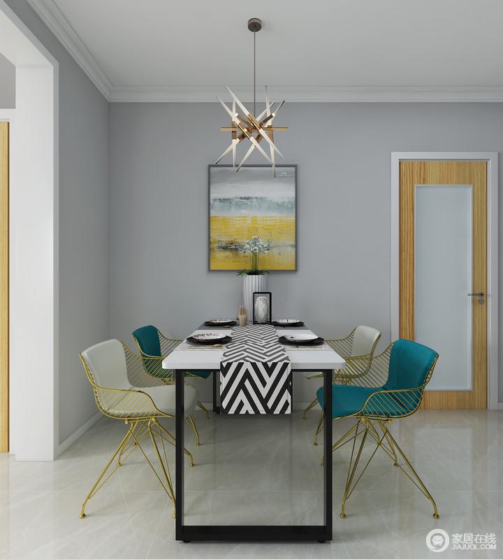 简简单单的餐厅,配合着活泼的颜色加上别致的餐桌和金属餐椅带给你不一样的餐厅体验,让用餐者食欲大增。